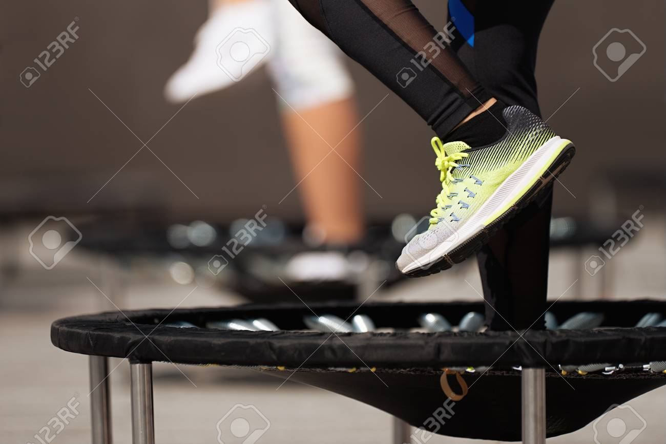 Fitness women jumping on small trampolines,exercise on rebounder - 109066336