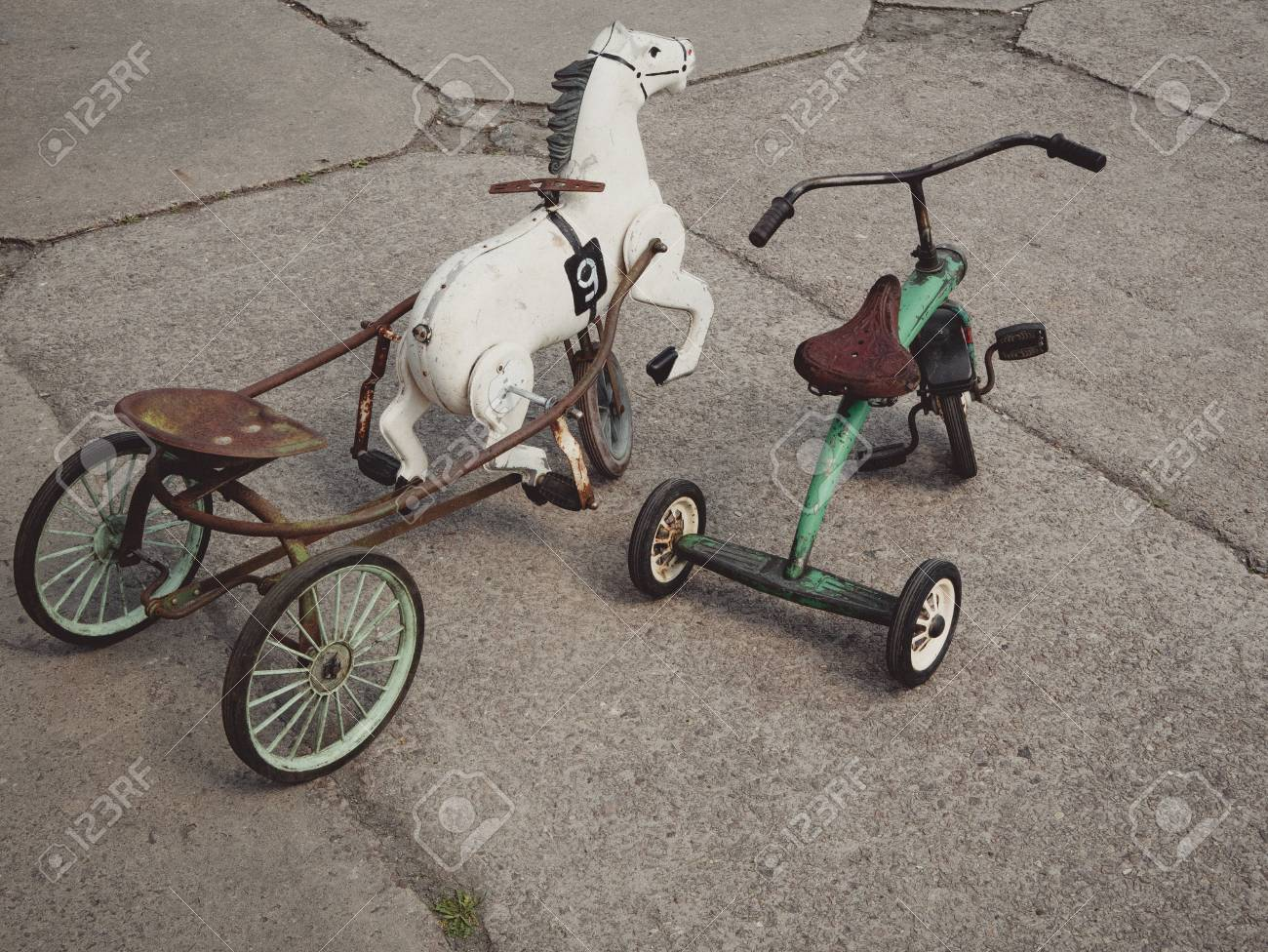 Vintage Bicycle Tricycle Toys With White Horse On A Playground Stock Photo Picture And Royalty Free Image Image 101335945