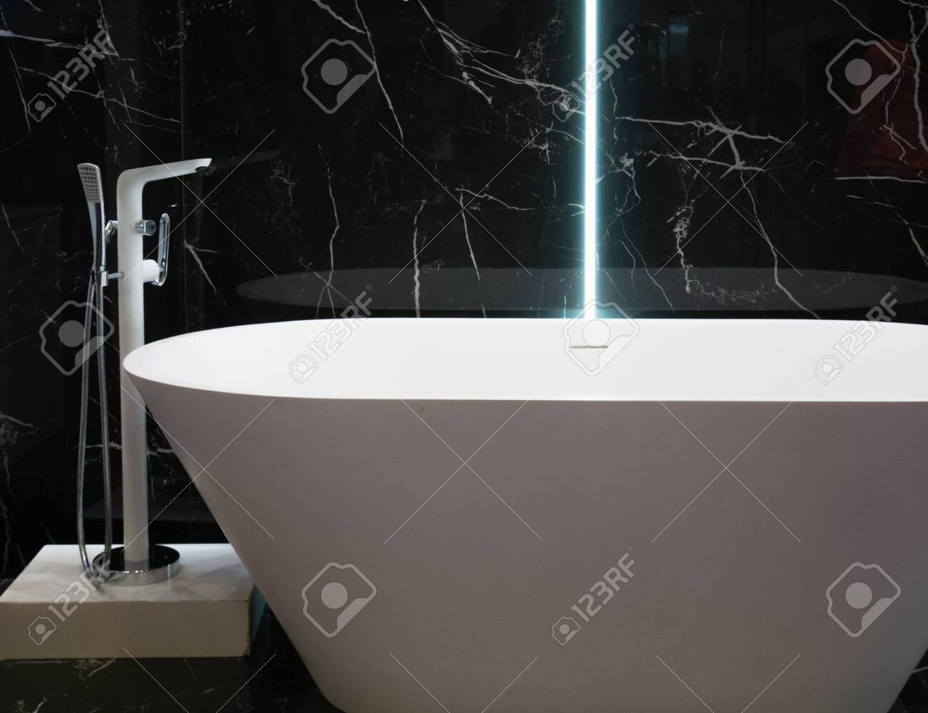 Modern White Bathtub At Hotel Apartment With Black Marble Wall Stock Photo Picture And Royalty Free Image Image 121187234