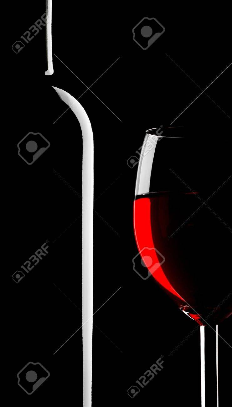 Abstract silhouette of wineglass and bottle on black Stock Photo - 8876184