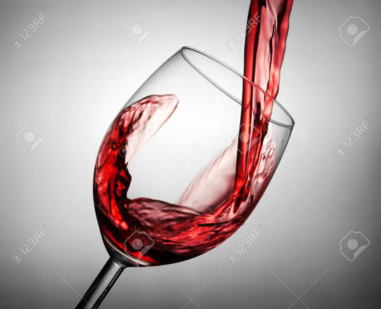 Pouring red wine in the glass Stock Photo - 9986568