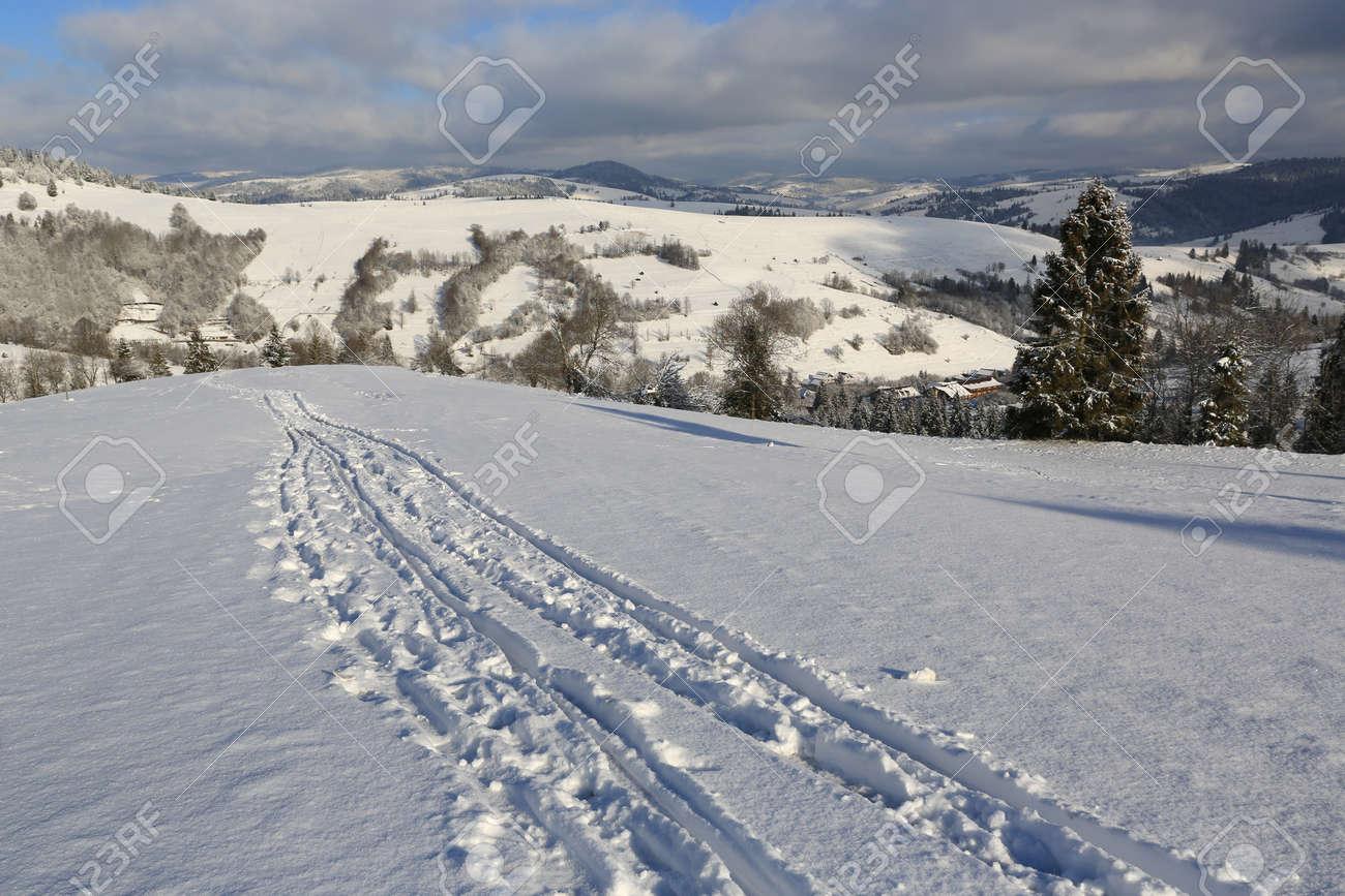 Scene with trail on winter mountain slope, Carpathians in Ukraine - 165452357