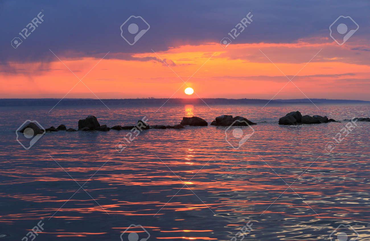 Nice sunset landscape on big lake - 168208833