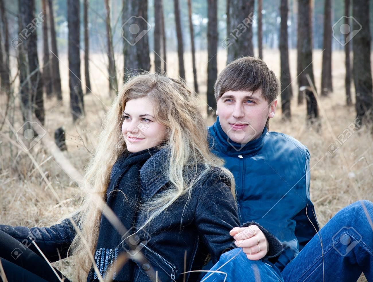 beautiful young couple smiling together in forest Stock Photo - 9096262