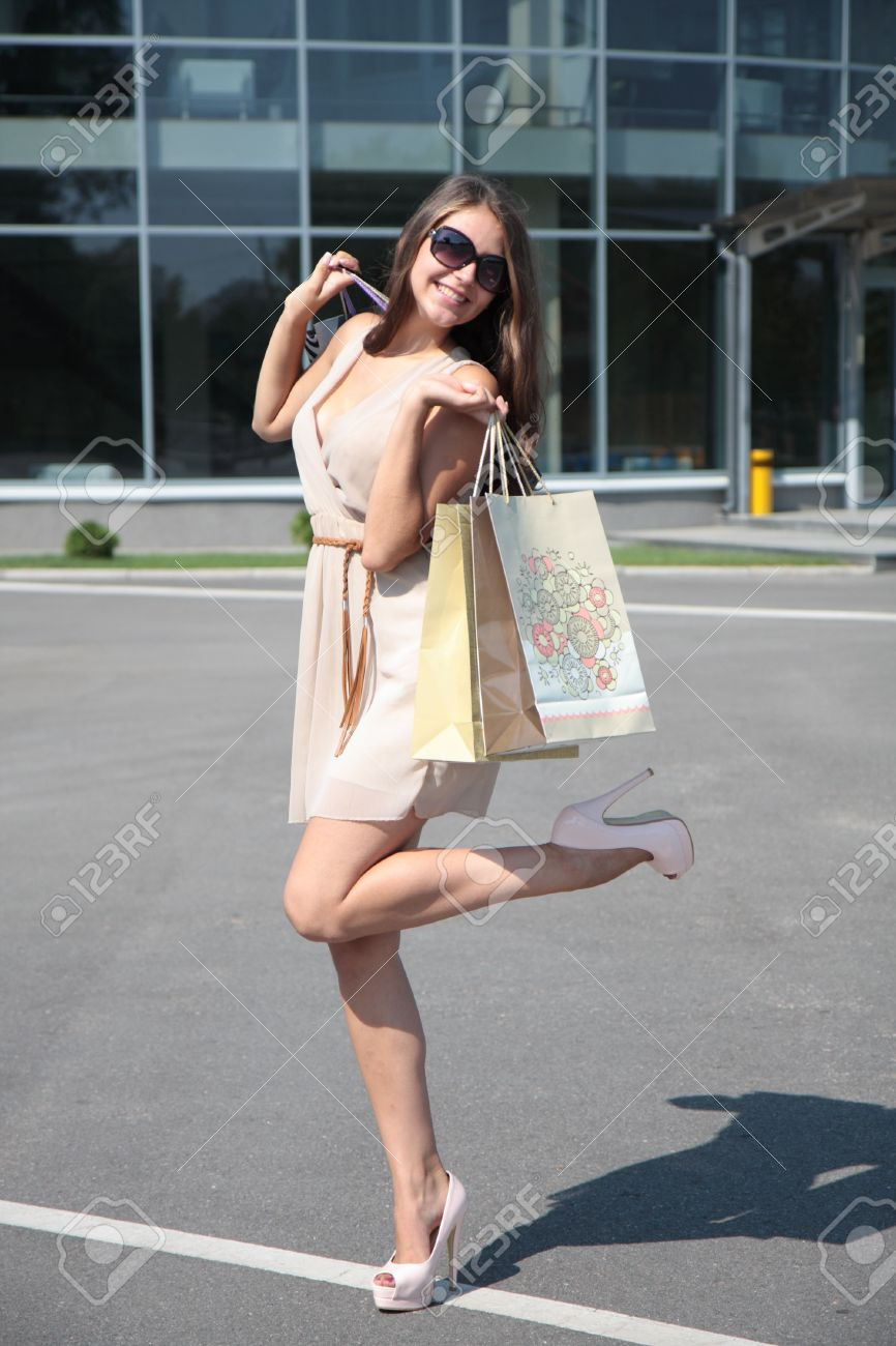 Happy girl with shopping on the street Stock Photo - 14625158