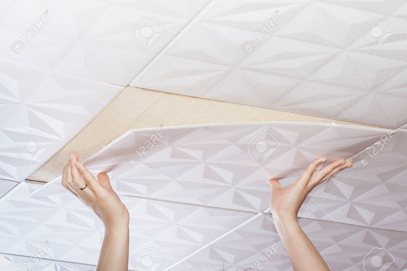 Installation Of Ceiling Tiles Made Of Polystyrene Stock Photo