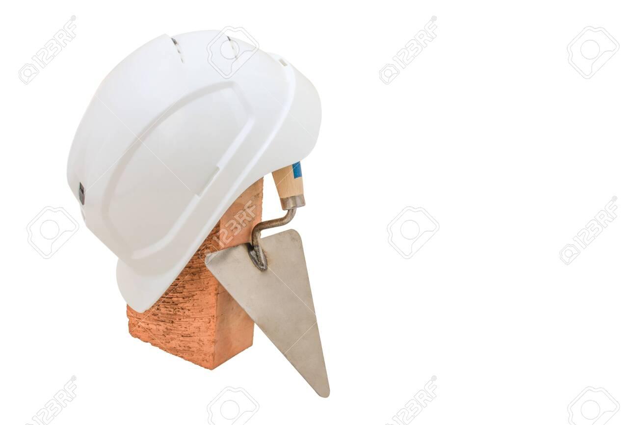 Bricklayer tools. Mason tools - Trowel, bricks and white helmet isolated on white background - 149773953