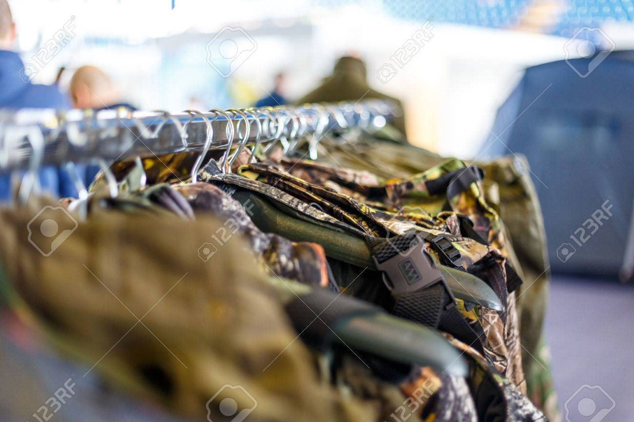 59b3b2ad50335 Hunting jackets and clothes hang on shelves in a hunting and fishing store  Stock Photo -