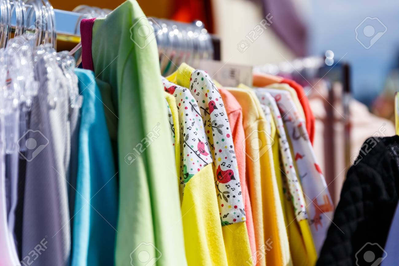 baby clothes pants t shirts sweaters shirts hanging on hangers