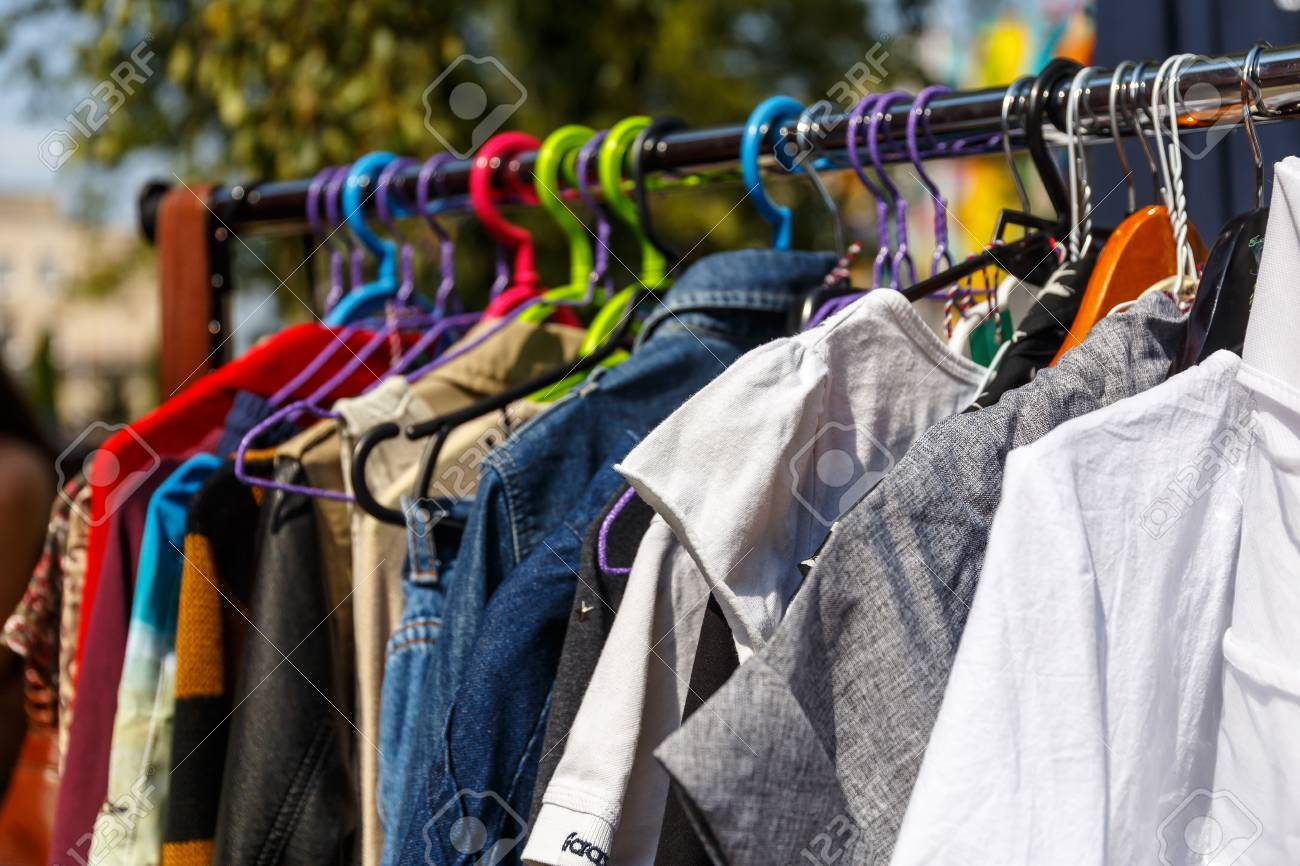 Hangers With Mens And Womens Clothing At The Garage Sale Stock Photo