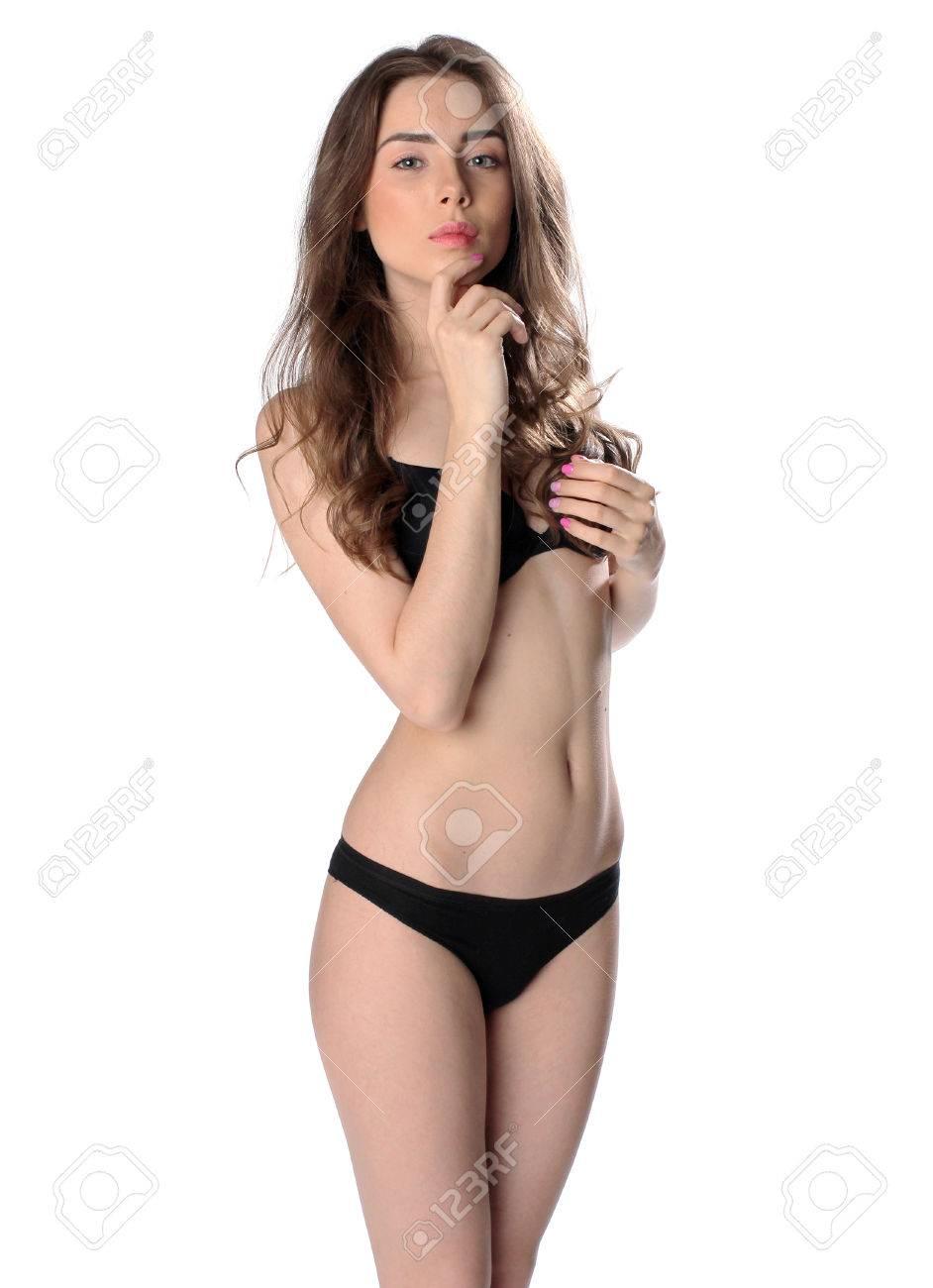 6da6b3a8d Foto de archivo - Hermosa mujer morena en bikini negro aislado en fondo  blanco