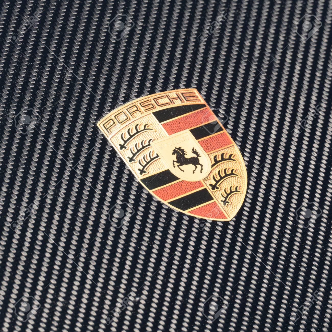 Porsche logo on carbon cars hood. Close up view. SEP 26, 2018..