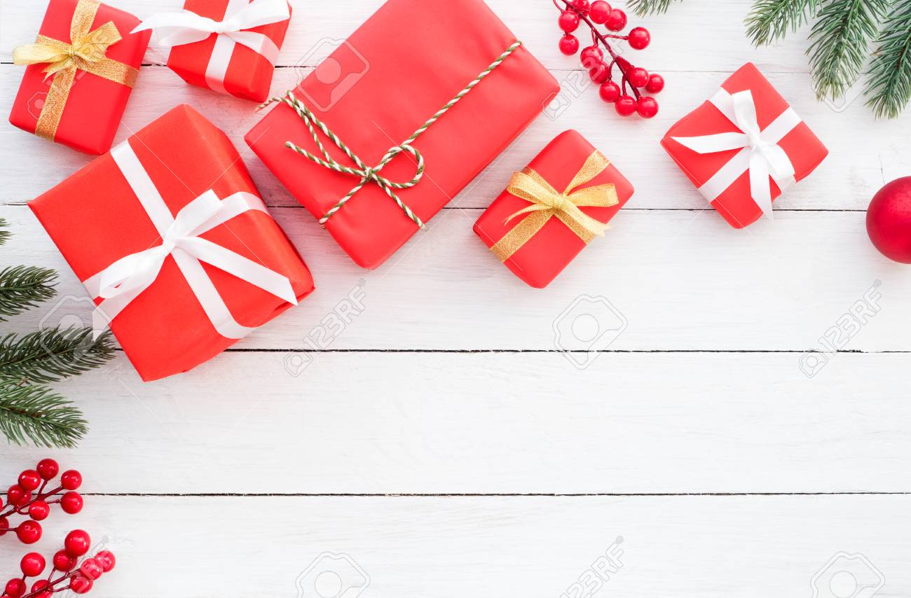 christmas and new year background christmas red gifts boxes with decoration rustic elements on white