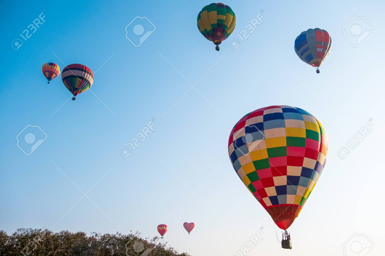 Colorful hot air balloon on blue sky - Image - 125550628