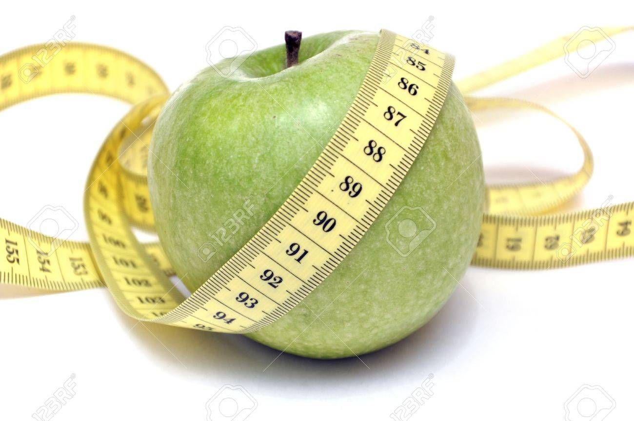 Green apple and tape measure Stock Photo - 15872943