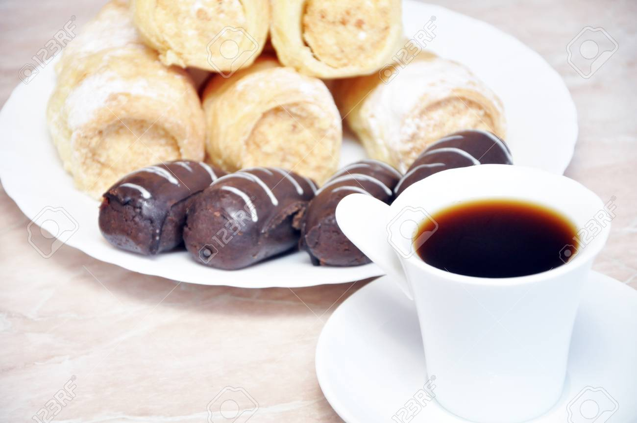 Puff pastry rolls with cream, chocolate and coffee potatoes Stock Photo - 17396951
