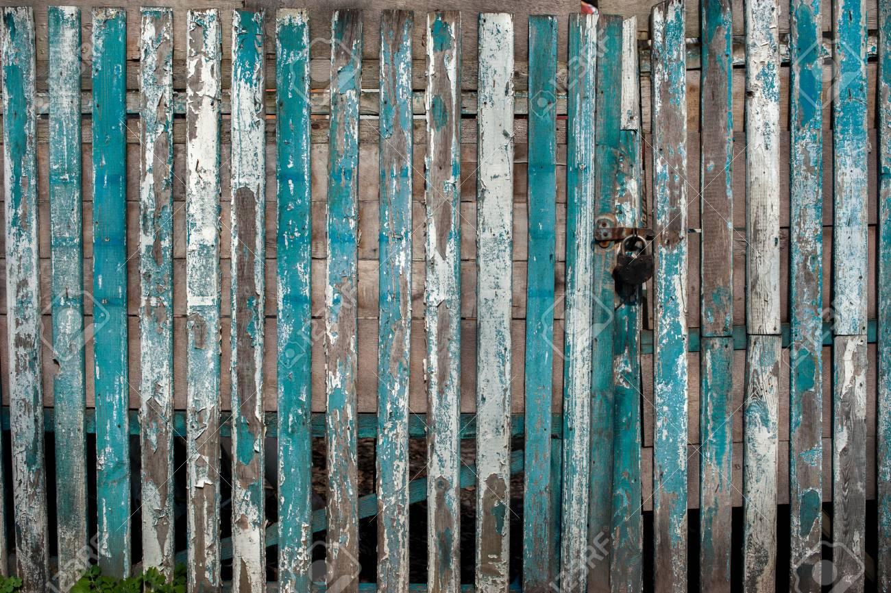 Wooden Rustic Door With Lock On Wallpaper Background Stock Photo