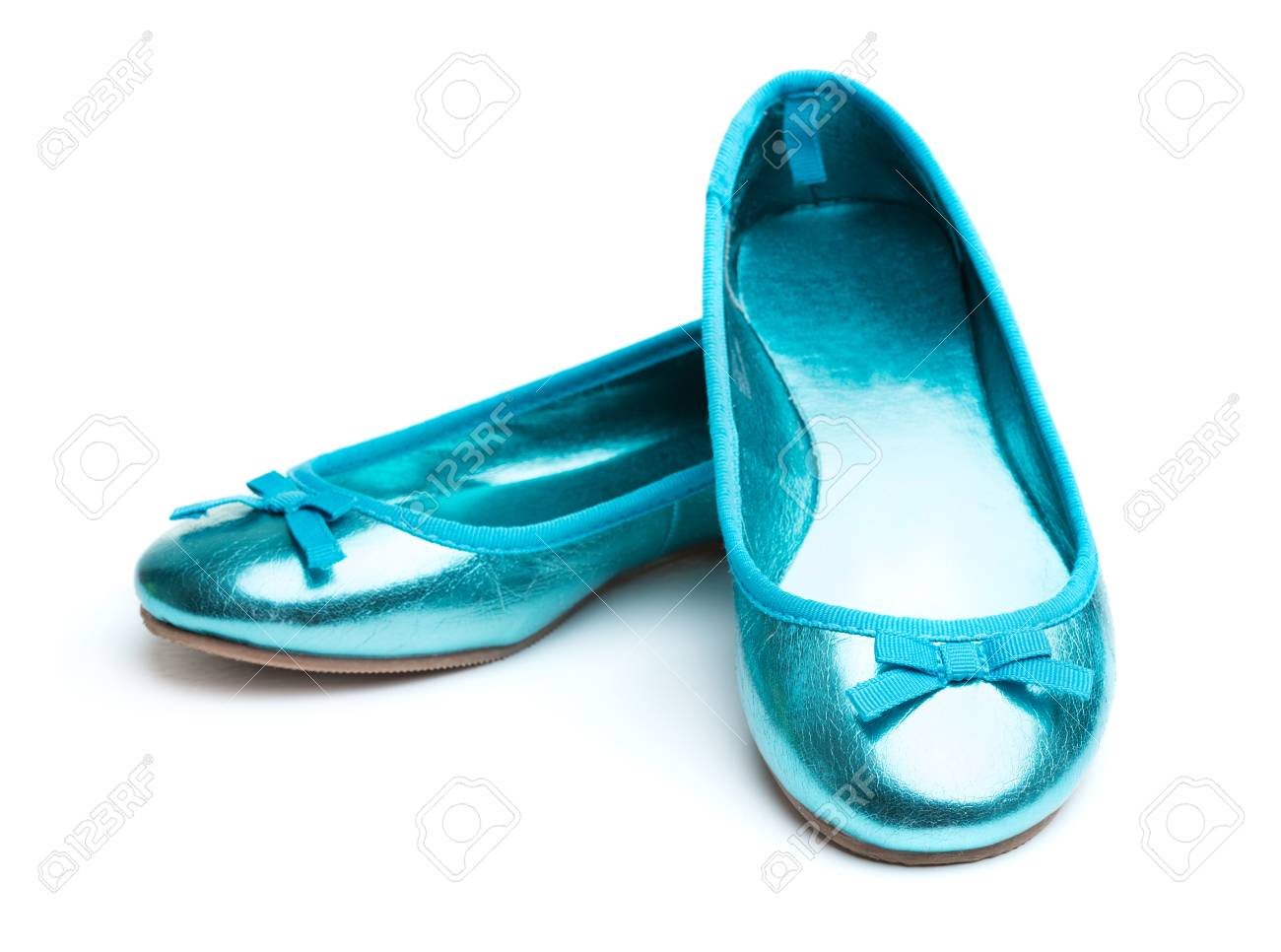 Pair Of Green Shiny Girl-shoes Isolated