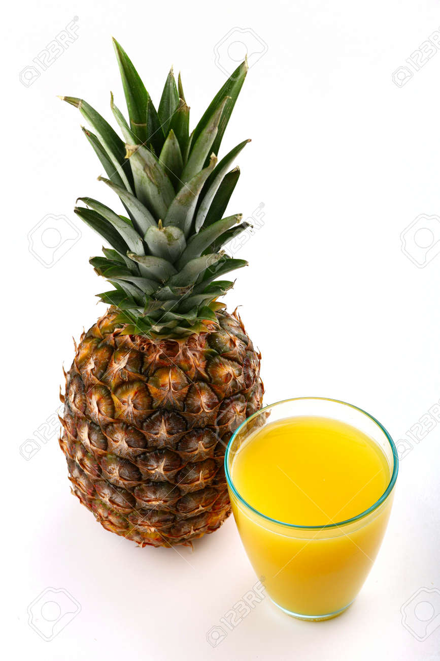 Pineapple and juice in a glass on a white background - 166007952