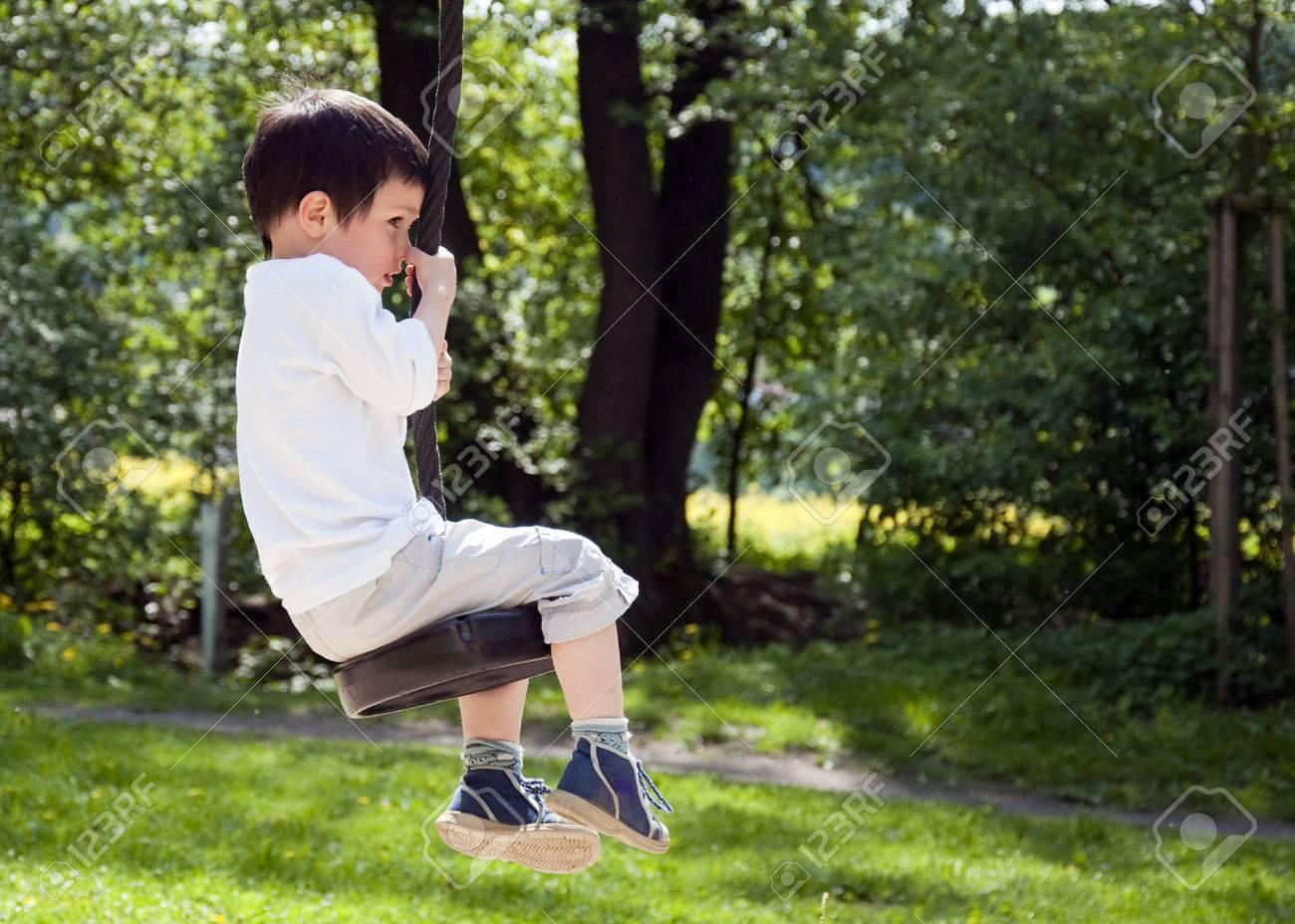 Tree Swing Child Boy Swinging On A Tree Swing In An Outdoor Adventure