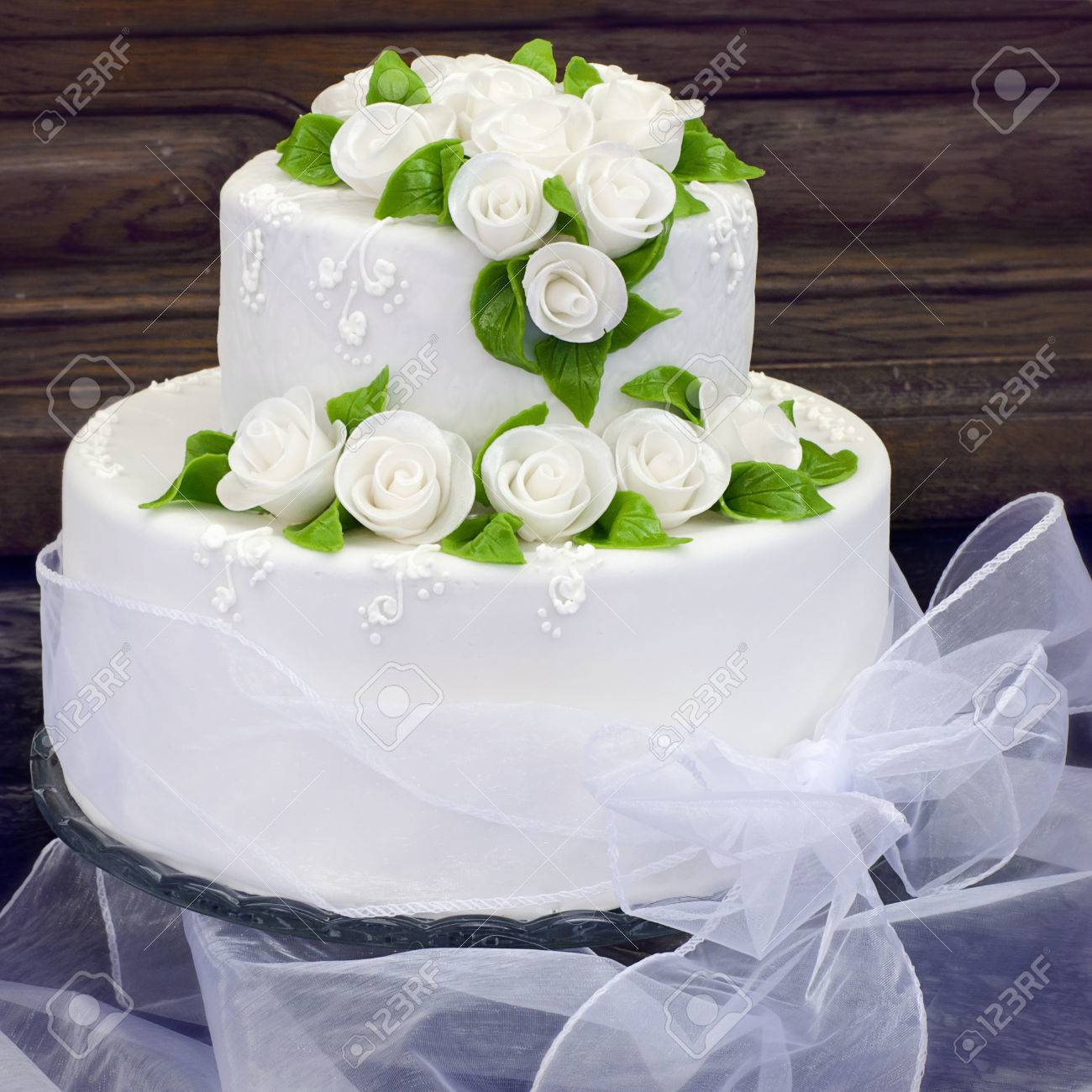 Wedding Cake With White Frosting Or Icing Decorated With White ...