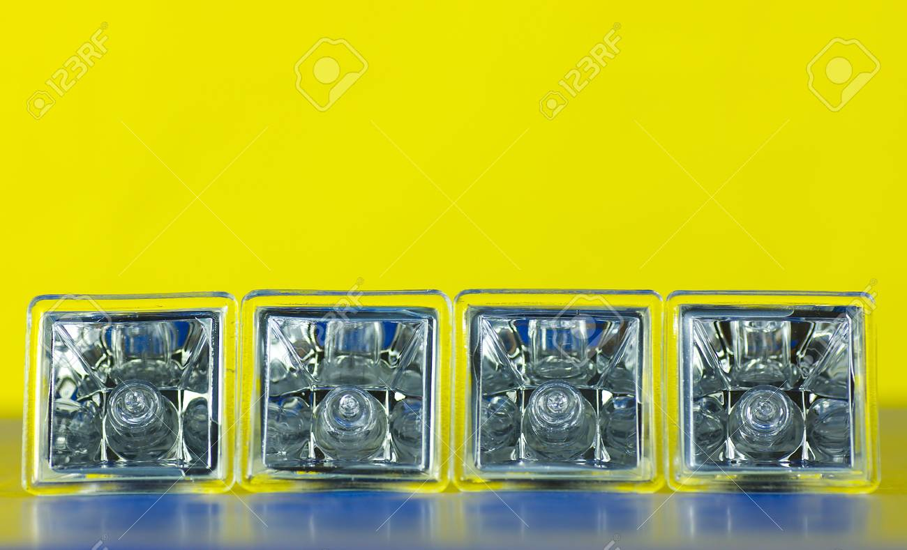 four decorative atypical square halogen light bulbs laying on side isolated on gradient background Stock Photo - 4727706