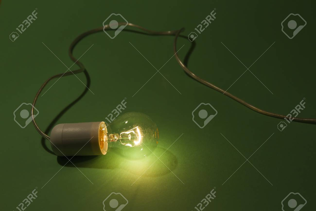 lightbulb laying on green background Stock Photo - 11032169