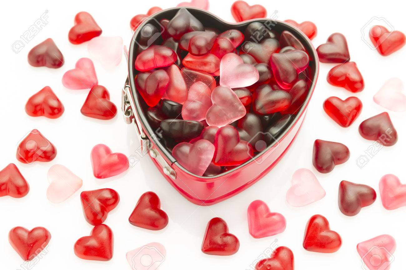 Valentine wallpaper with heart shaped mold filled with heart jelly valentine wallpaper with heart shaped mold filled with heart jelly beans 36469032 voltagebd Choice Image