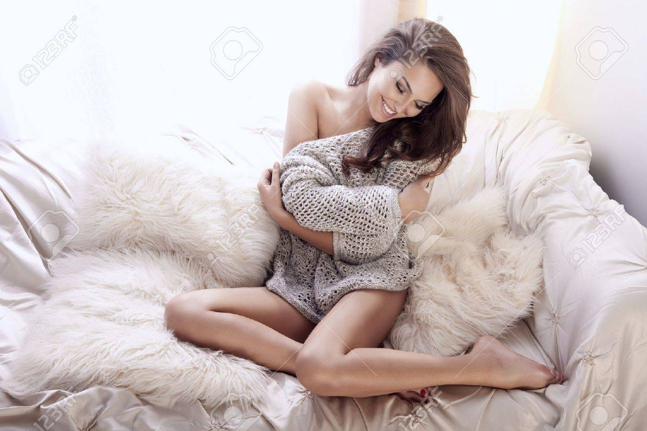 Beautiful and delicate woman relaxing in bright interior  Girl smiling Stock Photo - 17344813