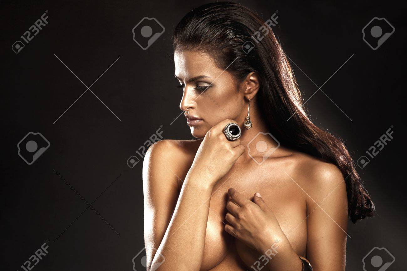 Portrait of beautiful brunette lady with ideal skin wearing amazing ring Stock Photo - 17799069