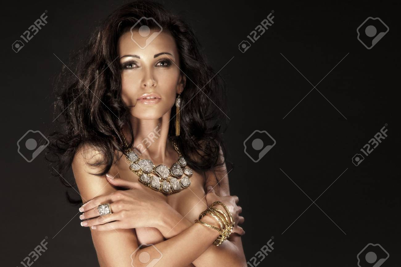 Portrait of wonderful brunette lady looking at camera wearing amazing jewellery. Stock Photo - 18299643