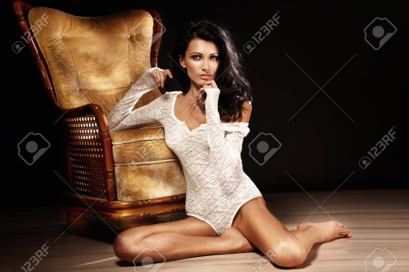 Beautiful girl with long hair sitting on the floor wearing sexy lace clothes Stock Photo - 18299644