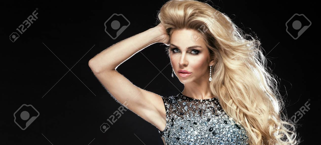 Sensual portrait of elegant young blonde woman looking at camera Stock Photo - 19501578