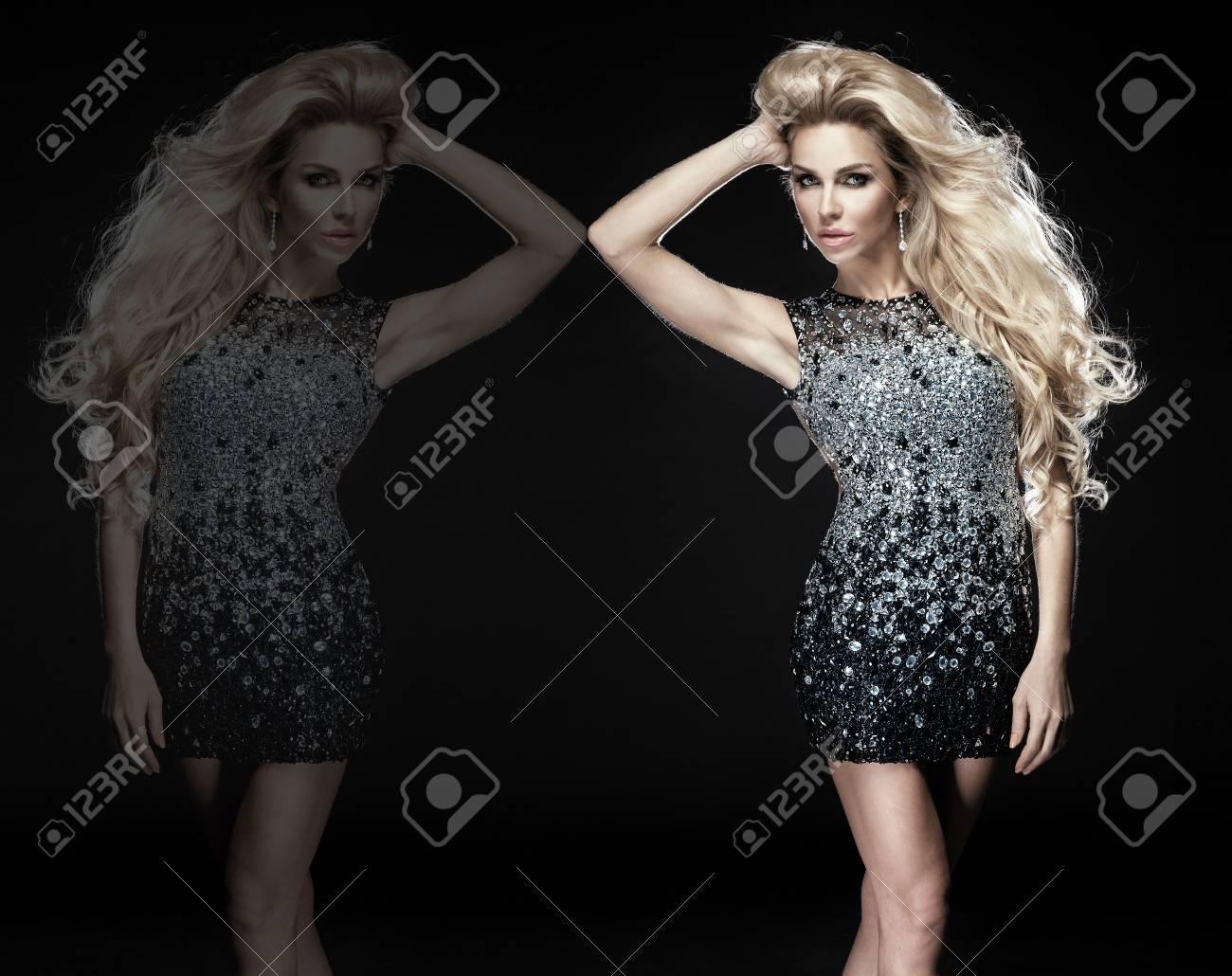 Fashionable young blonde sensual woman posing in elegant diamond dress. Long curly hair. Stock Photo - 19476094
