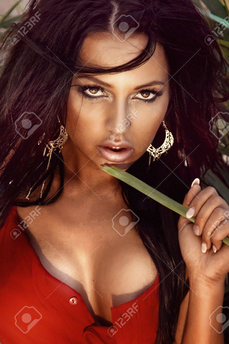 Portrait of beautiful brunette woman with amazing eyes looking at camera. Stock Photo - 21828361