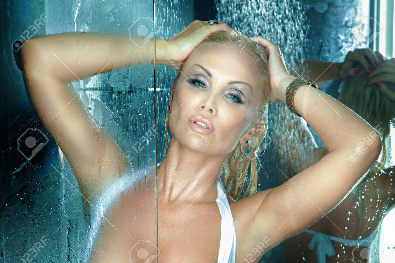 Portrait Of Beautiful Blonde Woman Taking Shower Looking At Camera Stock Photo 22614008