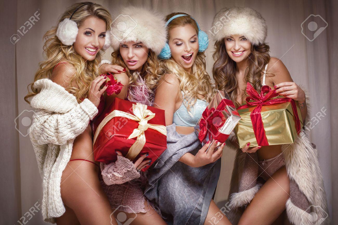 beautiful sexy group of santa girls ladies holding christmas gifts stock photo 67567449