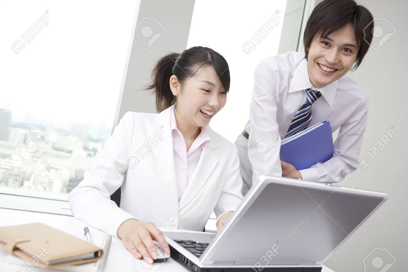 Office workers operating PC Stock Photo - 6194488