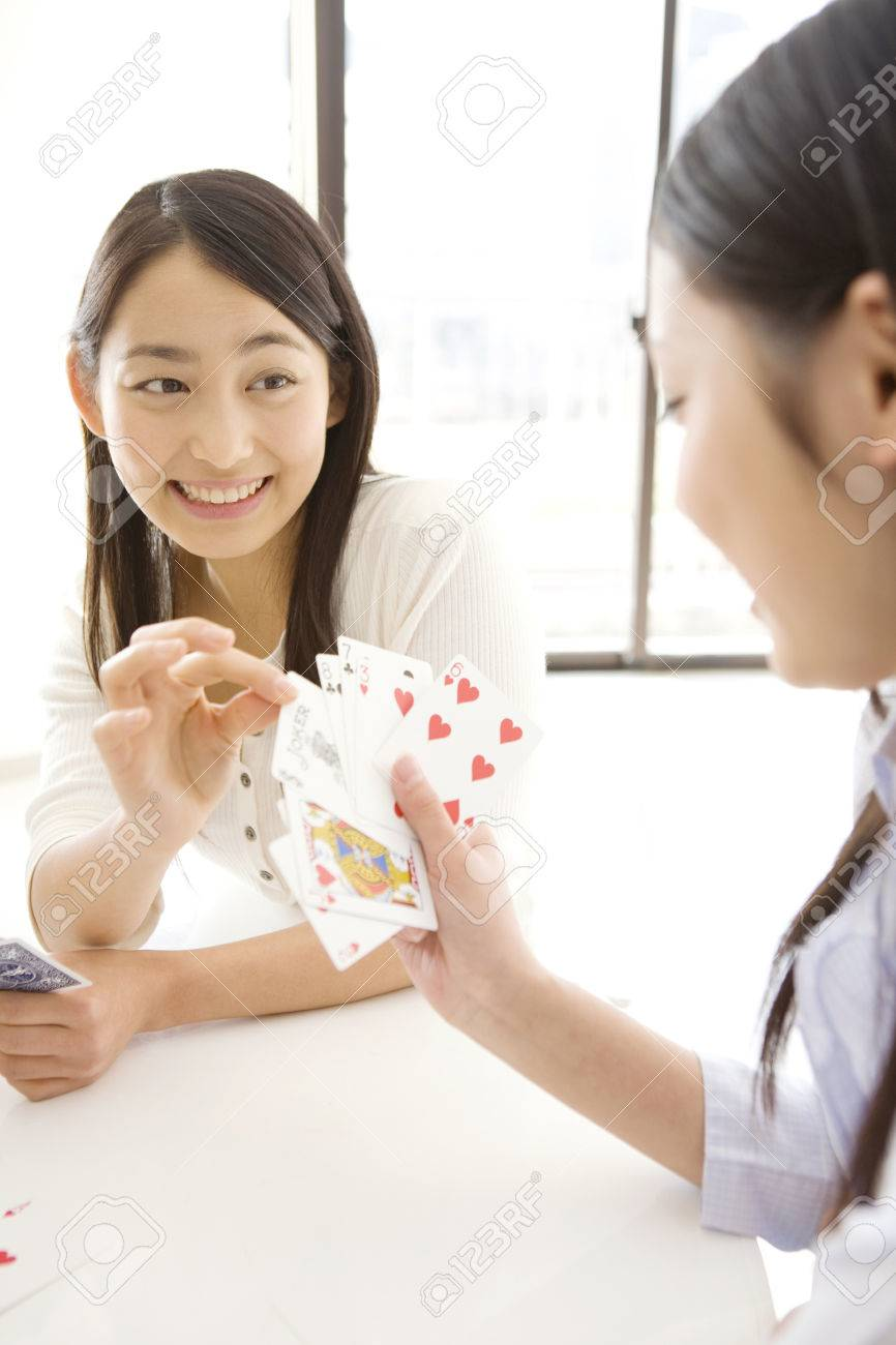 Japanese young woman playing a cards Stock Photo - 6194840