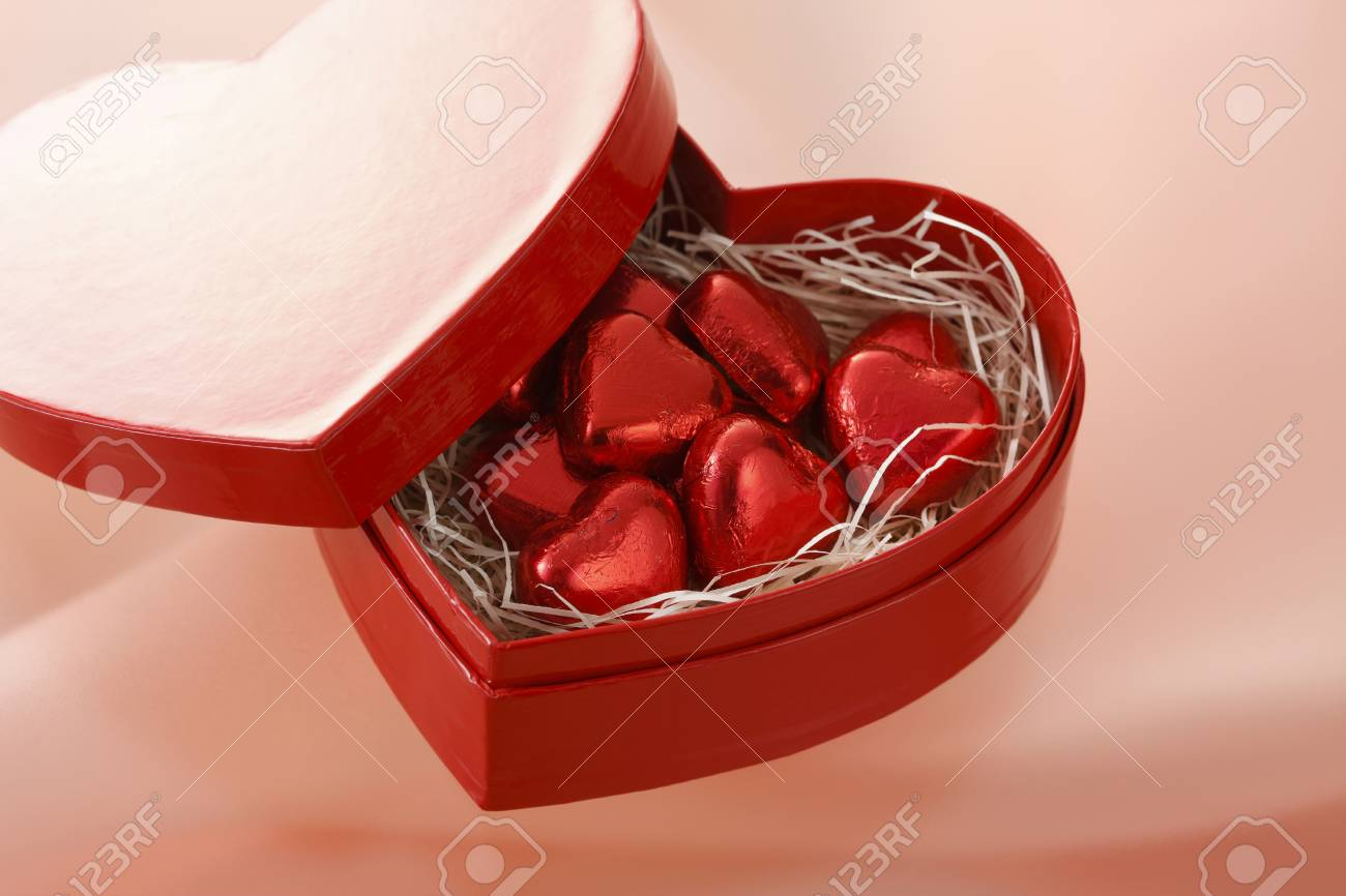 Some red chocolate in the heart box. Stock Photo - 6804609