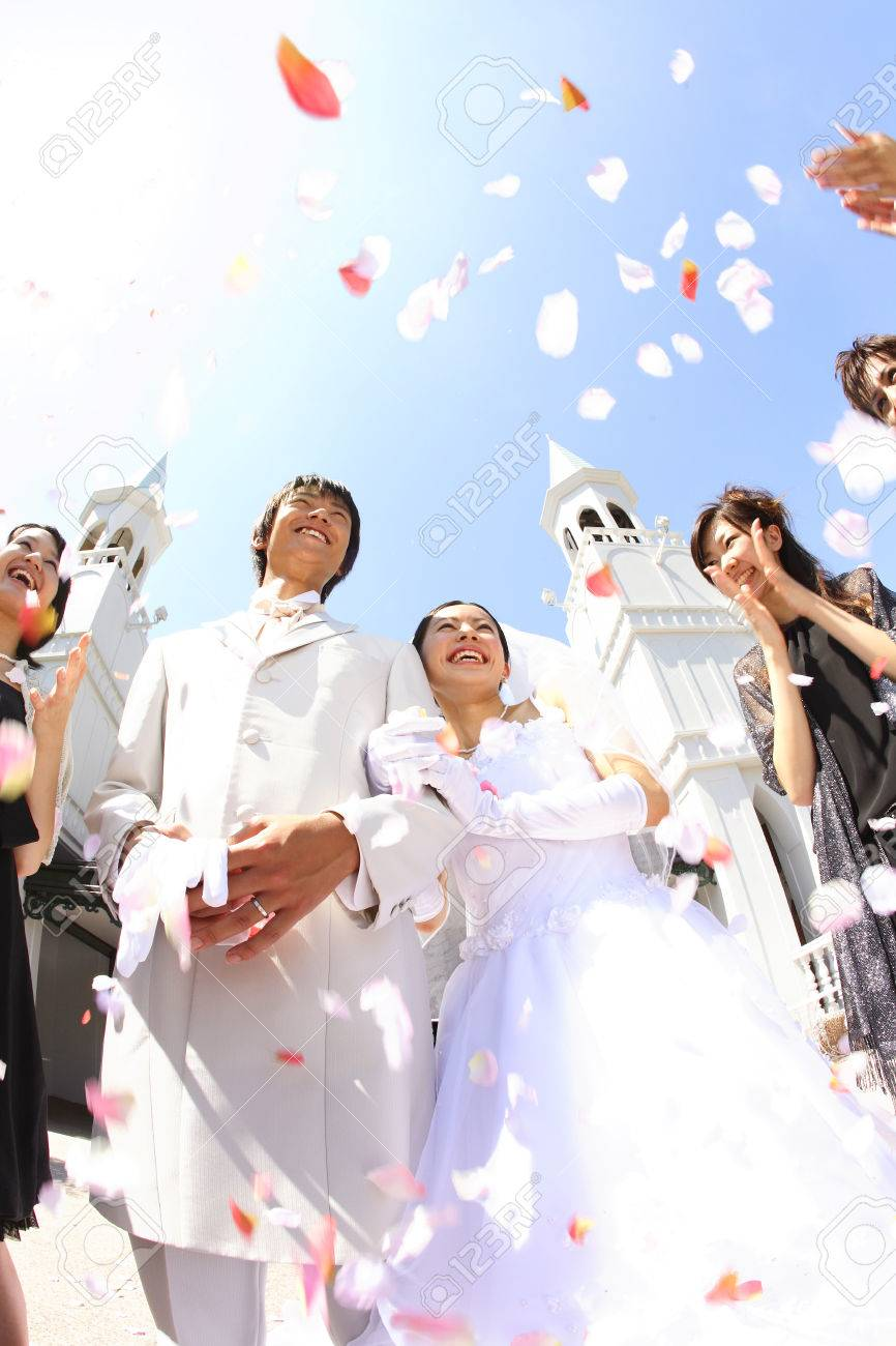 Bride And Groom Receive The Flower Shower Blessings Stock Photo ...