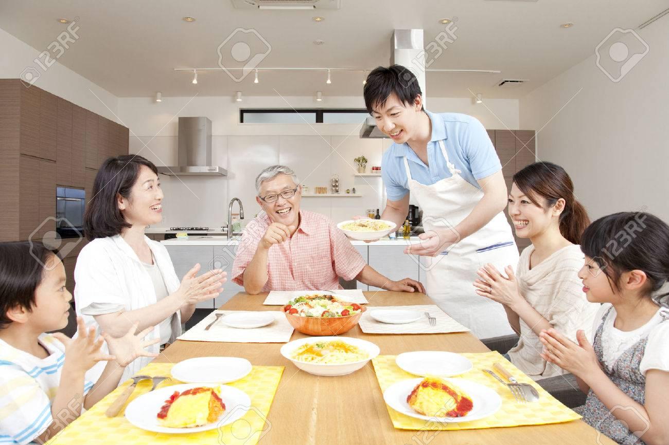 Surrounding the table three generation family - 43739776