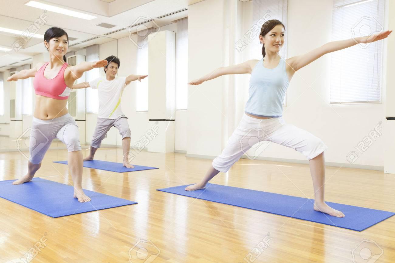 Men and women to do yoga Standard-Bild - 49519267