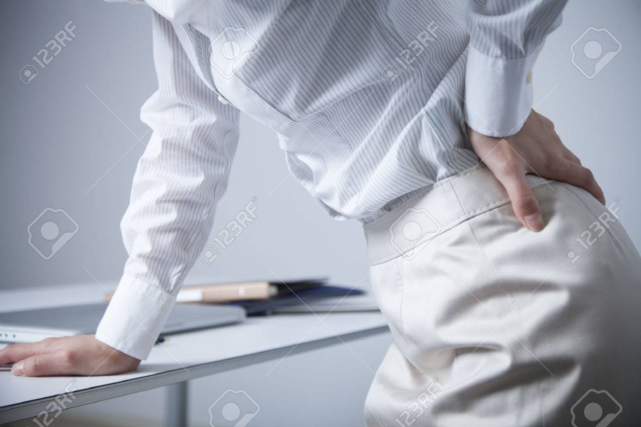 office lady suffering from low back pain - 51371738