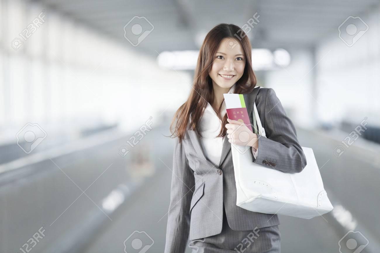 Businesswoman you have a passport walk a passage Standard-Bild - 51459576