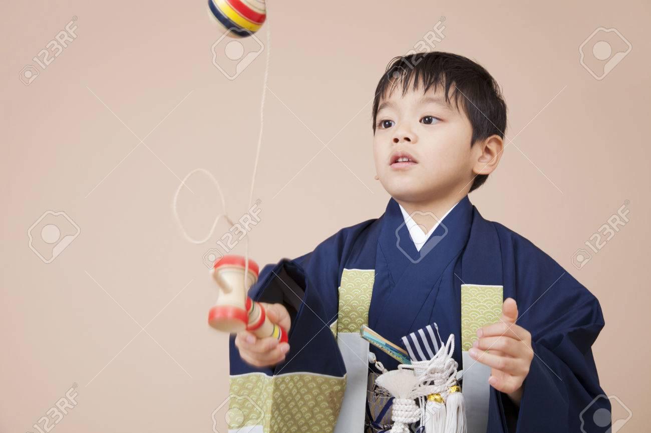 Boys playing in kendama - 51460659