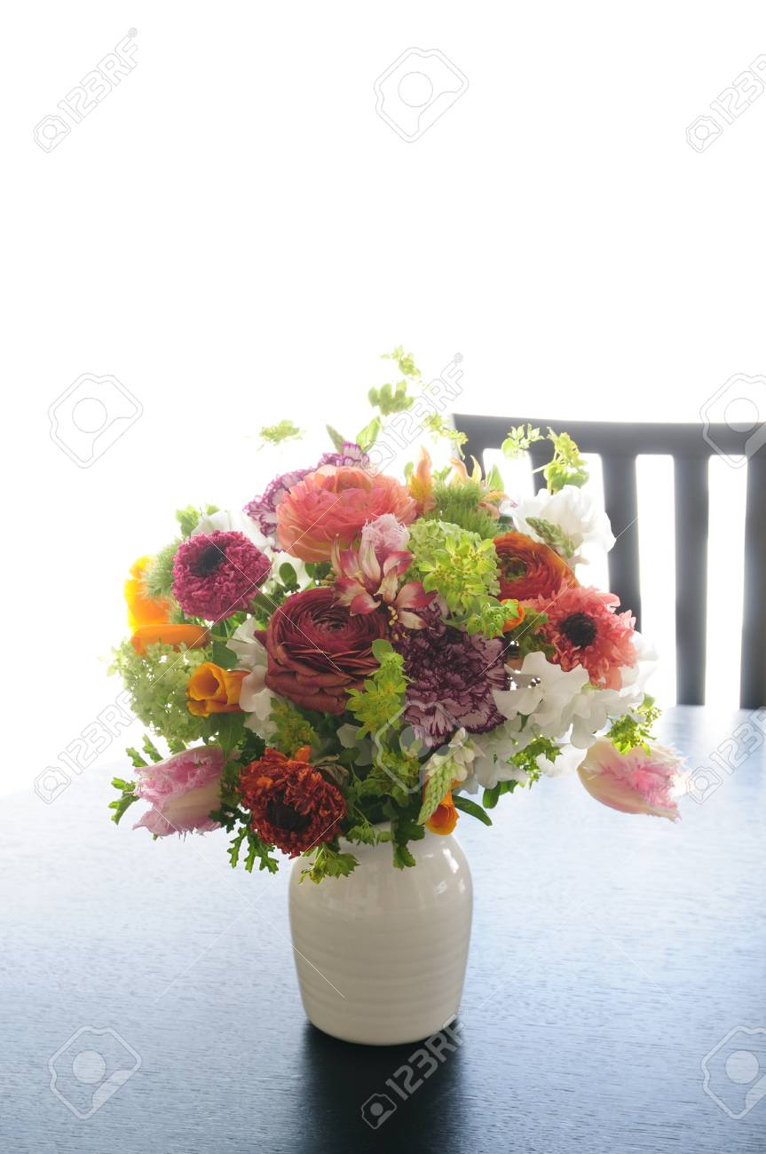 Flowers Of Spring Put On A Living Room Table Vase Flower Arrangements Stock Photo, Picture And Royalty Free Image. Image 39587978.