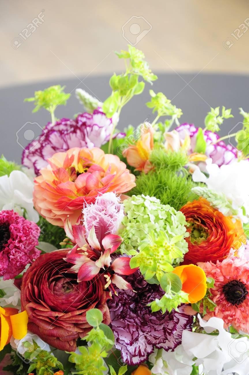 123RF.com & Flowers of spring put on a living room table vase flower arrangements