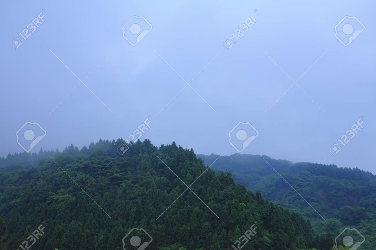 Mountains to smoking in rain