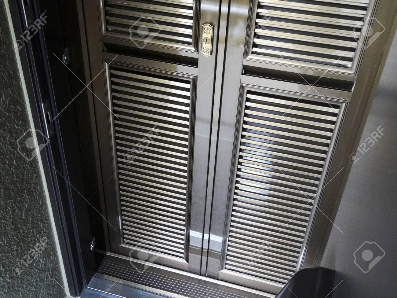 Screen door of the apartment entrance door
